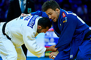 Warsaw, Poland - 2017 April 20: Adrian Gomboc from Slovenia (blue) competes with Nijat Shikhalizada from Azerbaijan (white) while the men&rsquo;s 66kg semifinal during European Judo Championships 2017 at Torwar Hall on April 20, 2017 in Warsaw, Poland.<br /> <br /> Mandatory credit:<br /> Photo by &copy; Adam Nurkiewicz / Mediasport<br /> <br /> Adam Nurkiewicz declares that he has no rights to the image of people at the photographs of his authorship.<br /> <br /> Picture also available in RAW (NEF) or TIFF format on special request.<br /> <br /> Any editorial, commercial or promotional use requires written permission from the author of image.