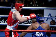 Milan, 01-09-2009 ITALY - Aiba World Boxing Championship Milan 2009.  Super Heavy +91 kg preliminaries..Pictured: Cammarelle Roberto ITA red vs Hunter Michael USA blue.Photo by Giovanni Marino/OTNPhotos . Obligatory Credit