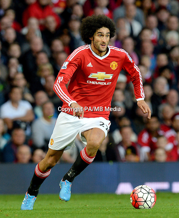 """Manchester United's Marouane Fellaini during the Barclays Premier League match at Old Trafford, Manchester. PRESS ASSOCIATION Photo. Picture date: Saturday September 12, 2015. See PA story SOCCER Man Utd. Photo credit should read: Martin Rickett/PA Wire. EDITORIAL USE ONLY No use with unauthorised audio, video, data, fixture lists, club/league logos or """"live"""" services. Online in-match use limited to 45 images, no video emulation. No use in betting, games or single club/league/player publications."""