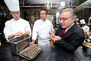 Alain Ducasse (R), chef Jerome Lacressonniere (C) and another unidentified kitchen hand (L) talk in the kitchen of Beige Alain Ducasse Tokyo in the Ginza district of Tokyo, Japan .Photographer: Robert Gilhooly