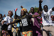 BANJUL, GAMBIA - JAN 26: Supporters of new president dance at the airport ahead of Gambia's President Adama Barrow arrival at Banjul International Airport after being sworn-in in neighbouring Senegal, on 26 January 2017 in Banjul, Gambia.