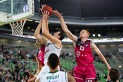 Rolands Zakis of Union Olimpija and Aaron White of Telekom Baskets Bonn during basketball match between KK Union Olimpija Ljubljana and Telekom Baskets Bonn (GER) in Round 3 of EuroCup 2015/16, on October 28, 2015 in Arena Stozice, Ljubljana, Slovenia. Photo by Matic Klansek Velej / Sportida.com