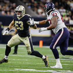 Aug 26, 2017; New Orleans, LA, USA; New Orleans Saints linebacker A.J. Klein (53) fights off a block from Houston Texans offensive tackle Kendall Lamm (63) during the first quarter of a preseason game at the Mercedes-Benz Superdome. Mandatory Credit: Derick E. Hingle-USA TODAY Sports