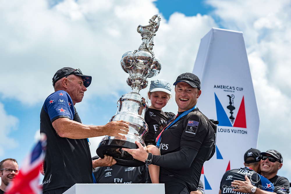 America's Cup Village, Bermuda, 26th June 2017. Emirates Team New Zealand CEO Grant Dalton and Skipper Glen Ashby with daughter Holly on stage with the America's Cup.
