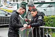Lewis Cook (16) of AFC Bournemouth signing his autograph for fans as he arrives at the Vitality Stadium as light snow falls before the Premier League match between Bournemouth and West Bromwich Albion at the Vitality Stadium, Bournemouth, England on 17 March 2018. Picture by Graham Hunt.