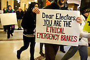 MADISON, WI – DECEMBER 19: Protestors displayed signs in the Wisconsin State Capitol rotunda urging the Wisconsin Presidential Electors to vote their conscience on Monday, December 19, 2016.
