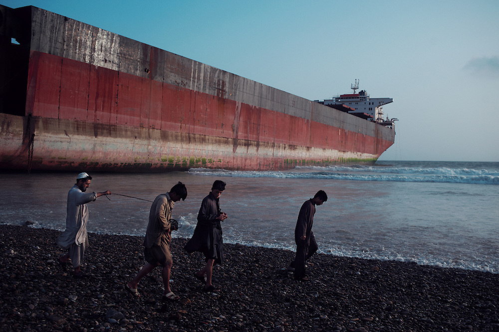 Scavengers Hussein, 18 years old, Waseem, 17 years old and Abdul, 15 years oldat the Gaddani Ship Breaking Yard, Balochistan Province, Pakistan on August 17, 2011. They once earned 7,000 Pakistani rupees($80 USD) in one day scavenging for metal..