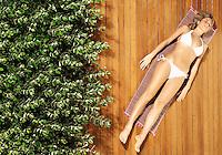 Young woman sunbathing in bikini view from above