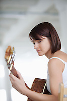 Woman sitting with accoustic guitar