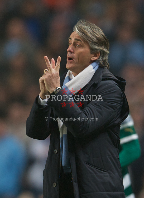 MANCHESTER, ENGLAND - Thursday, March 15, 2012: Manchester City's manager Roberto Mancini against Sporting Clube de Portugal during the UEFA Europa League Round of 16 2nd Leg match at City of Manchester Stadium. (Pic by David Rawcliffe/Propaganda)