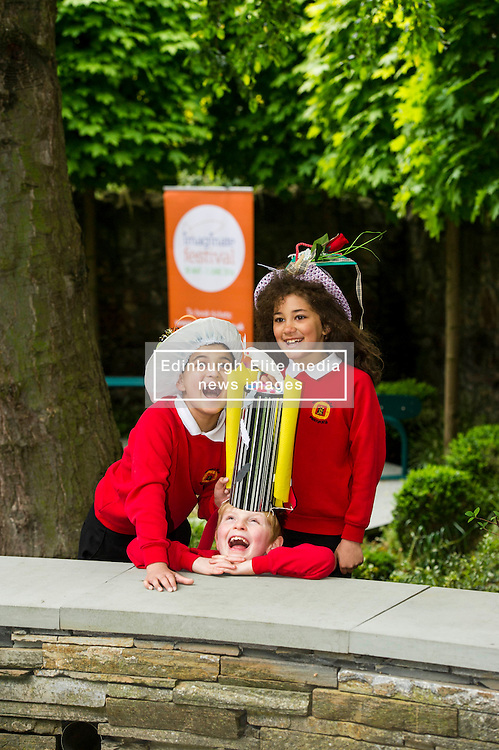 Pictured: Saim Sarwar (8), Harris Binnie (8) and Naeema Ahmd Aran (8) were having fun with the crazy hats.<br /> Pupils from Royal Mile Primary tried  on crazy hats made by a performer from company Mischief Labas, which is holding a hat-making workshop at the Imaginate opening weekend on May 28-29<br /> <br /> <br /> <br /> Ger Harley   EEm 26 May 2016