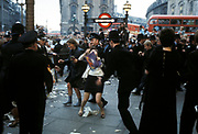 Police arresting two female demonstrators, Civil Rights march, Picadilly Circus, London, UK 1970