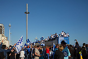 The open top buses pass by the British Airways i360 during the Brighton & Hove Albion Football Club Promotion Parade at Brighton Seafront, Brighton, East Sussex. United Kingdom on 14 May 2017. Photo by Ellie Hoad.