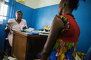 Rita Sahi, 25, who is 7-month pregnant with her third child, meets with a midwife during a prenatal consultation at the Libreville health center in Man, Cote d'Ivoire on Wednesday July 24, 2013.