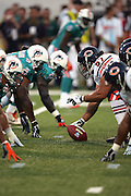 CANTON - AUGUST 8:  Center Olin Kreutz #57 of the Chicago Bears gets set to snap the ball against the Miami Dolphins at Pro Football Hall of Fame Field at Fawcett Stadium in Canton, Ohio on August 8, 2005. The Bears defeated the Dolphins 27-24. ©Paul Anthony Spinelli *** Local Caption *** Olin Kreutz