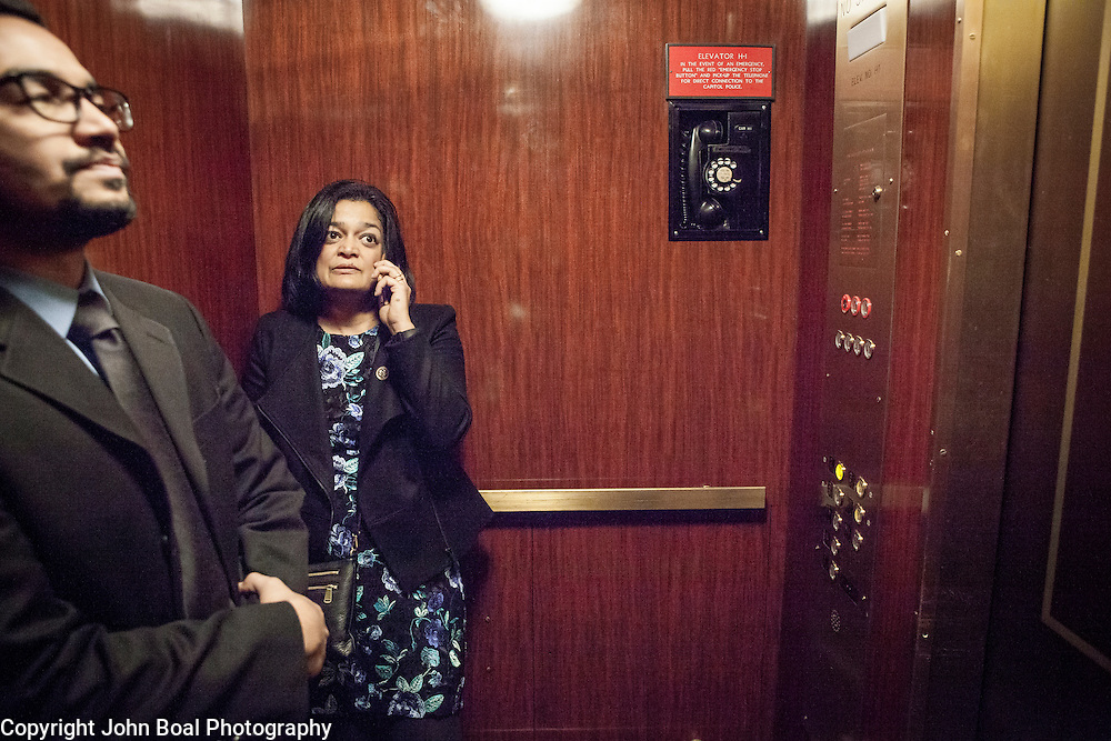 """Representative Pramila Jayapal (D-WA, 7), and Communications Director, Omer Farooque, take the elevator to the United States Capitol House Chambers, to support the introduction of H.R 724 by Rep. Zoe Lofgren (D-CA) to """"revoke President Trump's January 27, 2017 executive order...[and] block funding for any enforcement of the order,"""" on Tuesday, January 31, 2017.  John Boal photo/for The Stranger"""