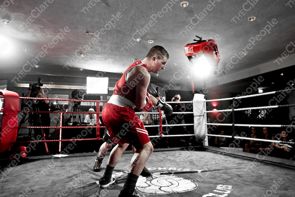 Cian Clancy - Red loses his head gear after a punch from Neil Hynes - Blue pictured taking part in the Fundraising Boxing Night in the Armada, Spanish Point on Sunday night.<br /> Pic. Brian Arthur/ Press 22.