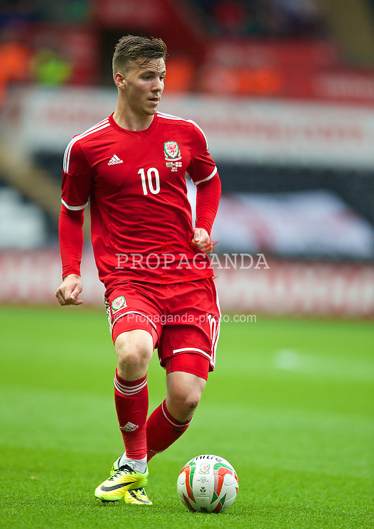SWANSEA, WALES - Monday, May 19, 2014: Wales' Lee Evans in action against England during the 2015 UEFA European Under-21 Championship Qualifying Group 1 match at the Liberty Stadium. (Pic by David Rawcliffe/Propaganda)