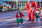 One of Santas elves - The run started on a very frosty track - 2000 Santas of all ages take part in the annual Santa Run in Battersea Park to support Noah's Ark Children's Hospice.