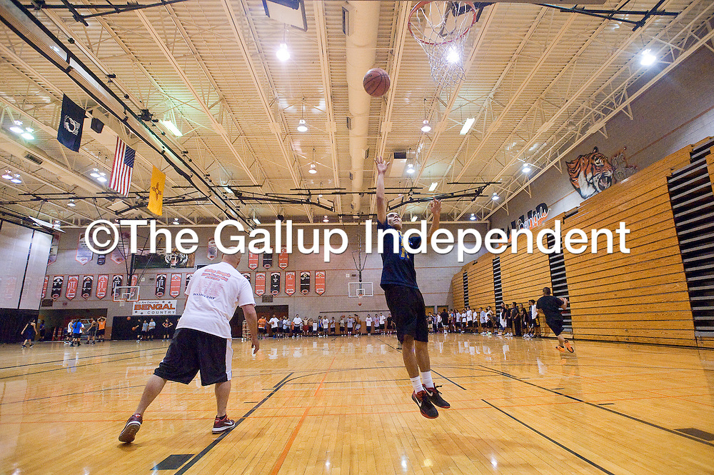 110612       Brian Leddy<br /> Gallup High School students practice during basketball tryouts at the school Monday evening.