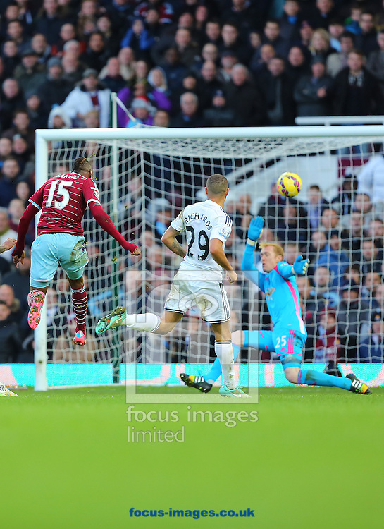 Diafra Sakho of West Ham United scores his side third goal to make it 3-1 during the Barclays Premier League match against Swansea City at the Boleyn Ground, London<br /> Picture by Richard Calver/Focus Images Ltd +447792 981244<br /> 07/12/2014