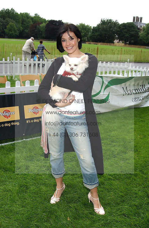 KYM MARSH and her dog Charlie at the 3rd annual Macmillan Dog Day in aid of Macmillan Cancer Relief held at Royal Hospital Chelsea, London SW3 on 5th July 2005.<br /><br />NON EXCLUSIVE - WORLD RIGHTS
