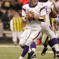 Jan 24, 2010; New Orleans, LA, USA; Minnesota Vikings quarterback Brett Favre (4) looks to pass during a 31-28 overtime victory by the New Orleans Saints over the Minnesota Vikings in the 2010 NFC Championship game at the Louisiana Superdome. Mandatory Credit: Derick E. Hingle-US PRESSWIRE