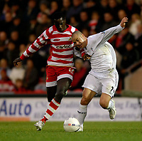 Photo: Jed Wee/Sportsbeat Images.<br />Doncaster Rovers v Bolton Wanderers. The FA Cup. 06/01/2007.<br /><br />Doncaster's Jonathan Forte (L) tries to muscle Bolton's Stelios Giannakopoulos off the ball.