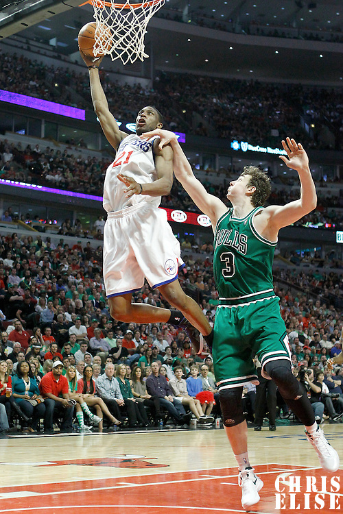 17 March 2012: Philadelphia Sixers forward Thaddeus Young (21) dunks on an offensive rebound over Chicago Bulls center Omer Asik (3) during the Chicago Bulls 89-80 victory over the Philadelphia Sixers at the United Center, Chicago, Illinois, USA.