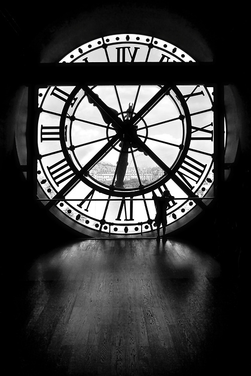 Watching Time Pass In Paris<br /> This little boy just stood in the shadows, watching time go by on the Seine, Paris. His body silhouetted against the light coming through one of the two clocks within the Mus&eacute;e d'Orsay.