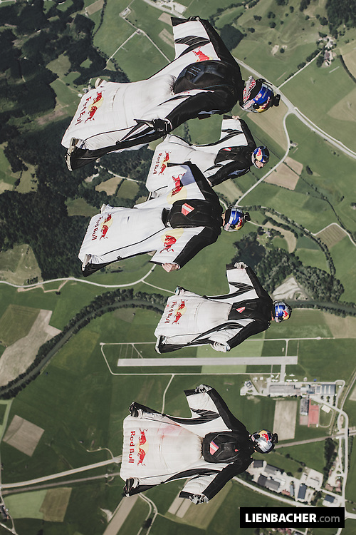 The Red Bull Skydive Team in a tight wingsuit formation over Niederöblarn (LOGO)