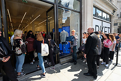 © Licensed to London News Pictures. 18/08/2017. London, UK. Customers queue and enter the opening of H&M group's first Weekday clothing store in Regent Street.  Weekday is know for its denizens offerings and minimalist styles, with 27 stores throughout Europe. Photo credit: Ray Tang/LNP
