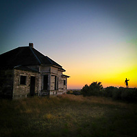 Photographer Alan Thornton watches the sun set near an abandoned house near Condon, Oregon (iPhone image)