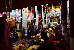 A picture made available on 19 September 2016 of Tibetan monks praying inside the Jokhang Temple in the early morning in Lhasa, Tibet Autonomous Region, China, 10 September 2016. Jokhang Temple is considered one of the most sacred site for Tibetan buddhists built during the rule of King Songtsen Gampo in the 7th century.