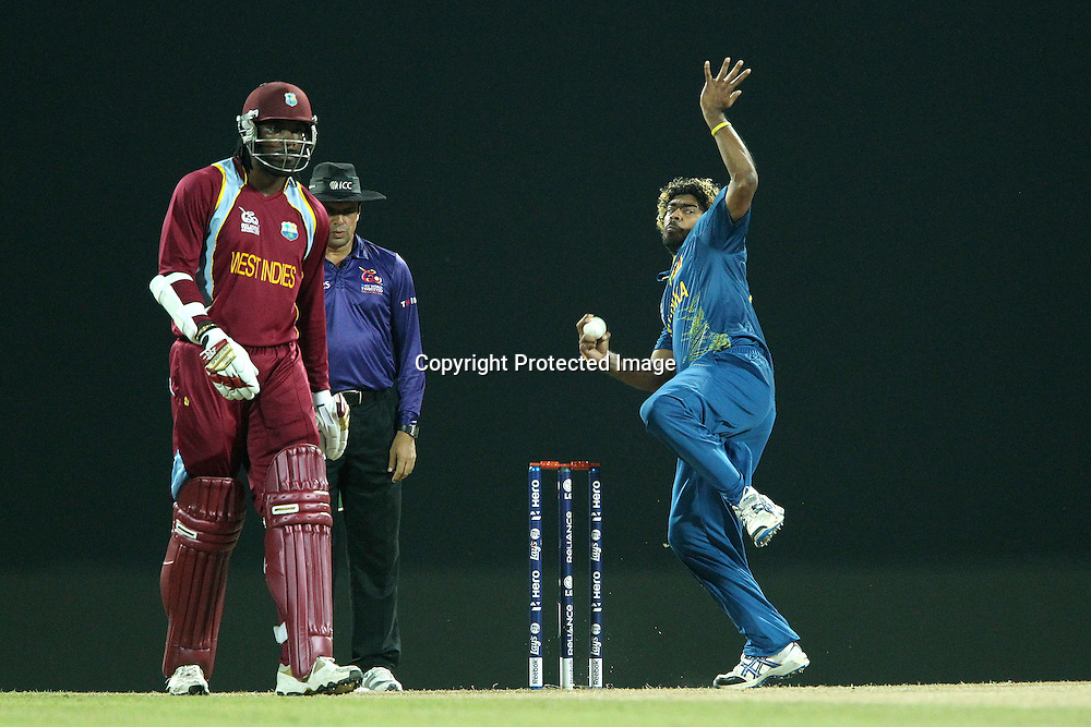 Chris Gayle of The West Indies prepares to run as Lasith Malinga bowls during the ICC World Twenty20 Super 8s match between Sri Lanka and The West Indies held at the  Pallekele Stadium in Kandy, Sri Lanka on the 29th September 2012<br /> <br /> Photo by Ron Gaunt/SPORTZPICS