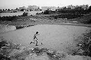 WEST BANK, Al- Masara: Two palestinian boys play football in a field in Al Masara village. Copyright Christian Minelli
