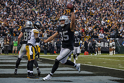 OAKLAND, CA - DECEMBER 09: Tight end Derek Carrier #85 of the Oakland Raiders celebrates after scoring a touchdown against the Pittsburgh Steelers during the fourth quarter at O.co Coliseum on December 9, 2018 in Oakland, California. The Oakland Raiders defeated the Pittsburgh Steelers 24-21. (Photo by Jason O. Watson/Getty Images) *** Local Caption *** Derek Carrier