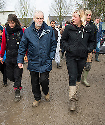 © Licensed to London News Pictures. 23/01/2016. Dunkirk, France. Leader of the Labour Party JEREMY CORBYN (centre) with MADDIE HARRIS (right) during a visit a temporary camp in Dunkirk, France, where thousands of migrants and refugees attempting to reach the UK are currently living. Photo credit: Ben Cawthra/LNP