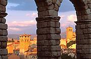 SPAIN, CASTILE, SEGOVIA Romanesque belltowers past arches