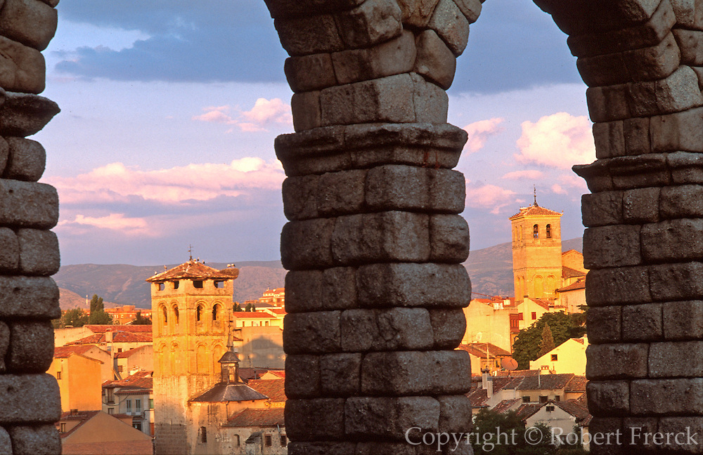 SPAIN, CASTILE, SEGOVIA Romanesque belltowers past arches