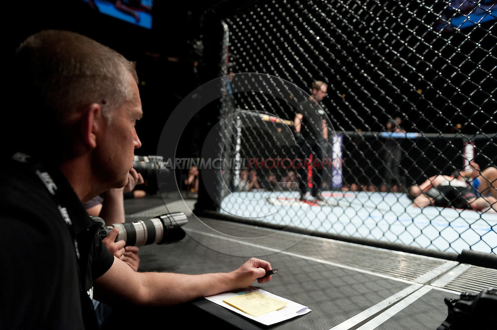 """STOCKHOLM, SWEDEN, APRIL 14: A judge watches John Maguire and DaMarques Johnson during """"UFC on Fuel TV: Gustafsson vs. Silva"""" inside the Ericsson Globe Arena in Stockholm, Sweden"""