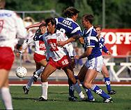 23.07.1991, Pori, Finland..Jalkapalloliiga / Finnish League, Porin Pallo-Toverit v Rovaniemen Palloseura.Jorma Heinonen (PPT) v Anders Eriksson & Hannu Ollila (RoPS).©Juha Tamminen