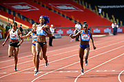 Shaunae Miller-Uibo (BAH), centre,  beats Dina Asher-Smith (GBR) right, to win the 200m wines race in a time of 22.24 during the Birmingham Grand Prix, Sunday, Aug 18, 2019, in Birmingham, United Kingdom. (Steve Flynn/Image of Sport via AP)