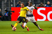 Tottenham Hotspur midfielder Moussa Sissoko (17) tackles Borussia Dortmund midfielder Mario Götze (10) during the Champions League round of 16, leg 2 of 2 match between Borussia Dortmund and Tottenham Hotspur at Signal Iduna Park, Dortmund, Germany on 5 March 2019.