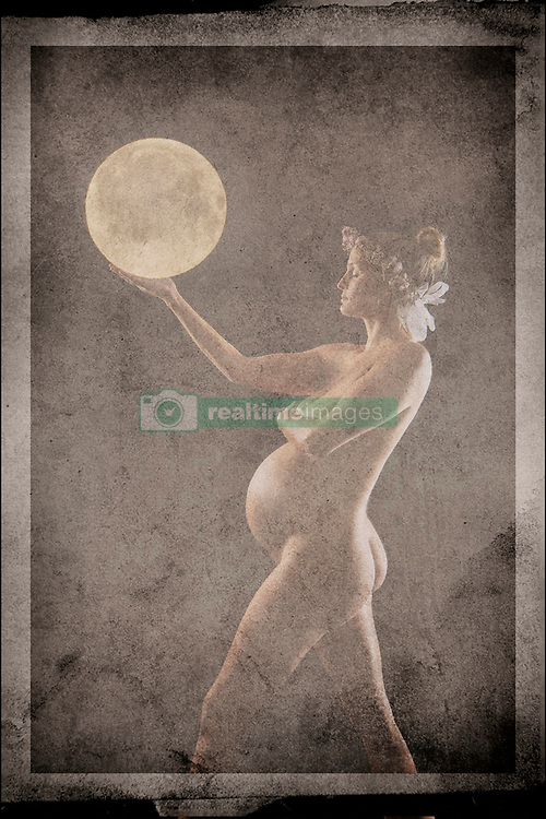 January 30, 2016 - Nude, pregnant woman, holding moon in hand, digital composite (Credit Image: © Pete Saloutos/Image Source via ZUMA Press)