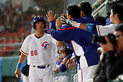 NEW TAIPEI CITY, TAIWAN - NOVEMBER 15:  Chien-Ming Chang #66 of Team Chinese Taipei is greeted in the dugout after scoring a run in the bottom of the fifth inning during Game 2 of the 2013 World Baseball Classic Qualifier against Team New Zealand at Xinzhuang Stadium in New Taipei City, Taiwan on Thursday, November 15, 2012.  Photo by Yuki Taguchi/WBCI/MLB Photos