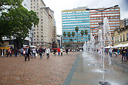 Fountains and people walking in Porte Alegre, Brazil.