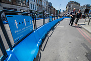 Transport for London organise wider pavements around Londnon Bridge, branded Steetspace, to help people keep their 2m distancing. The easing of the 'lockdown' continues for the Coronavirus (Covid 19) outbreak in London.