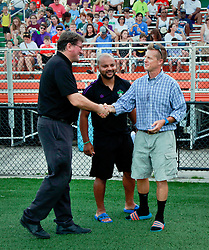 27 June 2015. New Orleans, Louisiana.<br /> National Premier Soccer League. NPSL. <br /> Jesters 1- Georgia Revolution 5.<br /> Jesters head coach Kenny Farrell and assistant Dwayne Jones greet Georgia Revolution head coach Robin Dixon at the Pan American Stadium. <br /> Photo©; Charlie Varley/varleypix.com