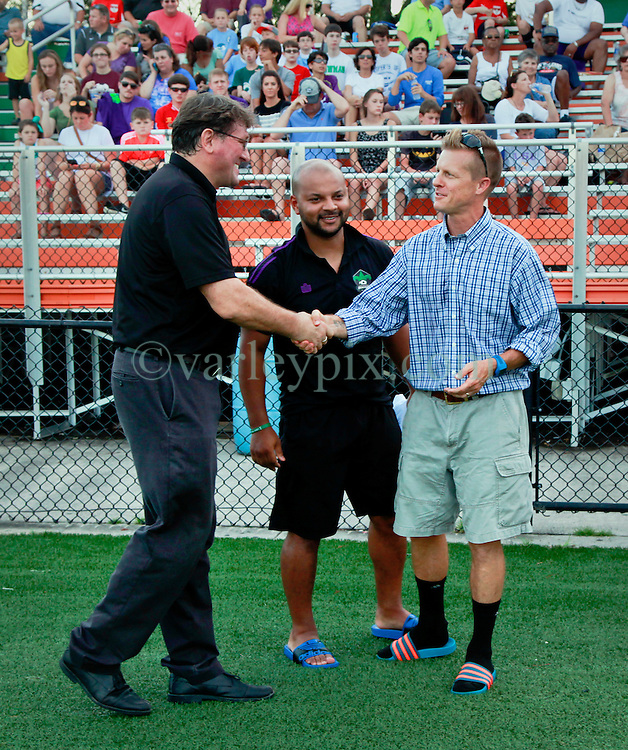 27 June 2015. New Orleans, Louisiana.<br /> National Premier Soccer League. NPSL. <br /> Jesters 1- Georgia Revolution 5.<br /> Jesters head coach Kenny Farrell and assistant Dwayne Jones greet Georgia Revolution head coach Robin Dixon at the Pan American Stadium. <br /> Photo&copy;; Charlie Varley/varleypix.com
